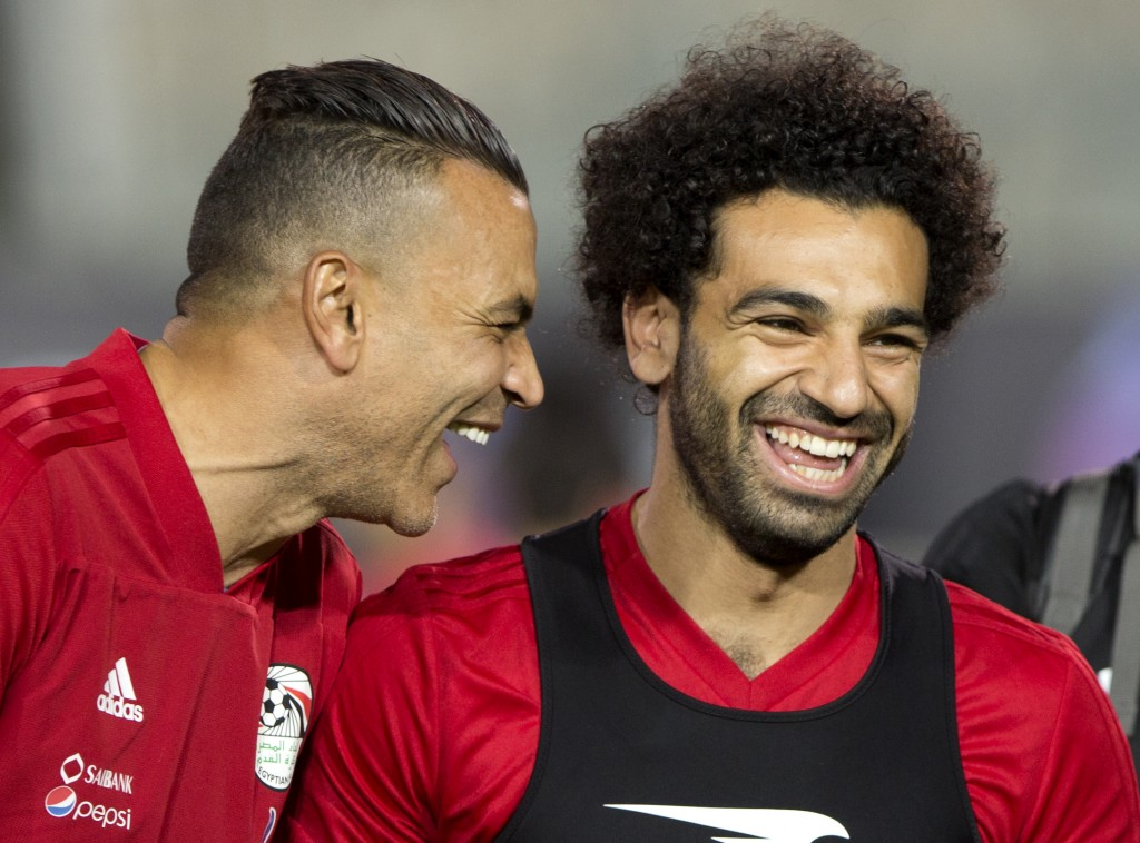 Egyptian national soccer team player and Liverpool's star striker Mohammed Salah, right, shares a laugh with goalkeeper Essam El Hadary during Egypt's