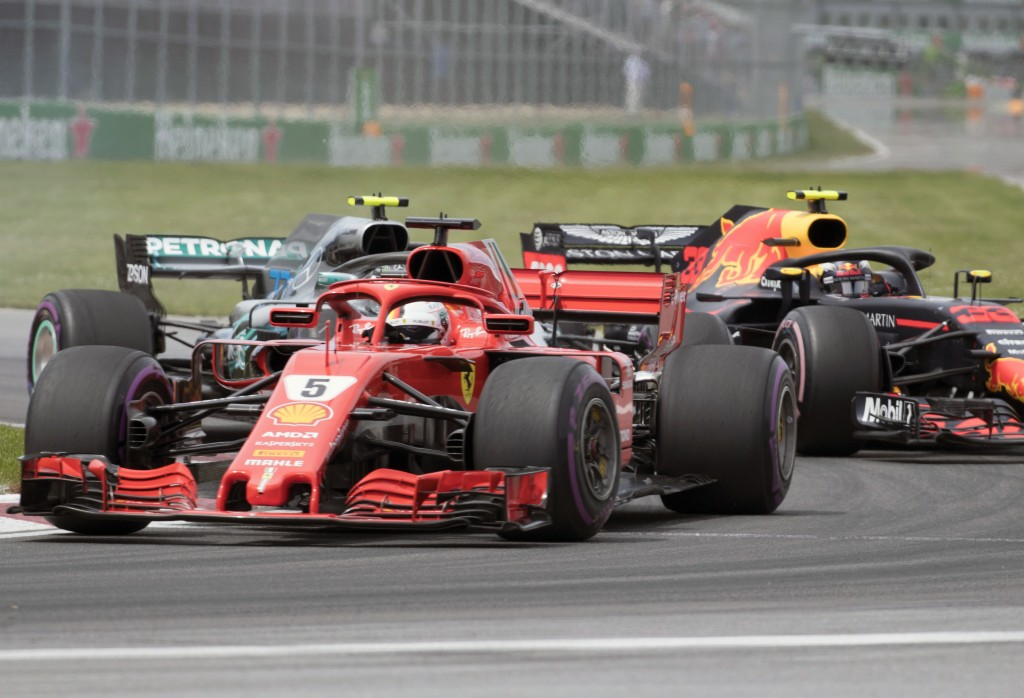 Ferrari driver Sebastian Vettel, of Germany leads Mercedes driver Valtteri Bottas, of Finland and Red Bull driver Max Verstappen, of