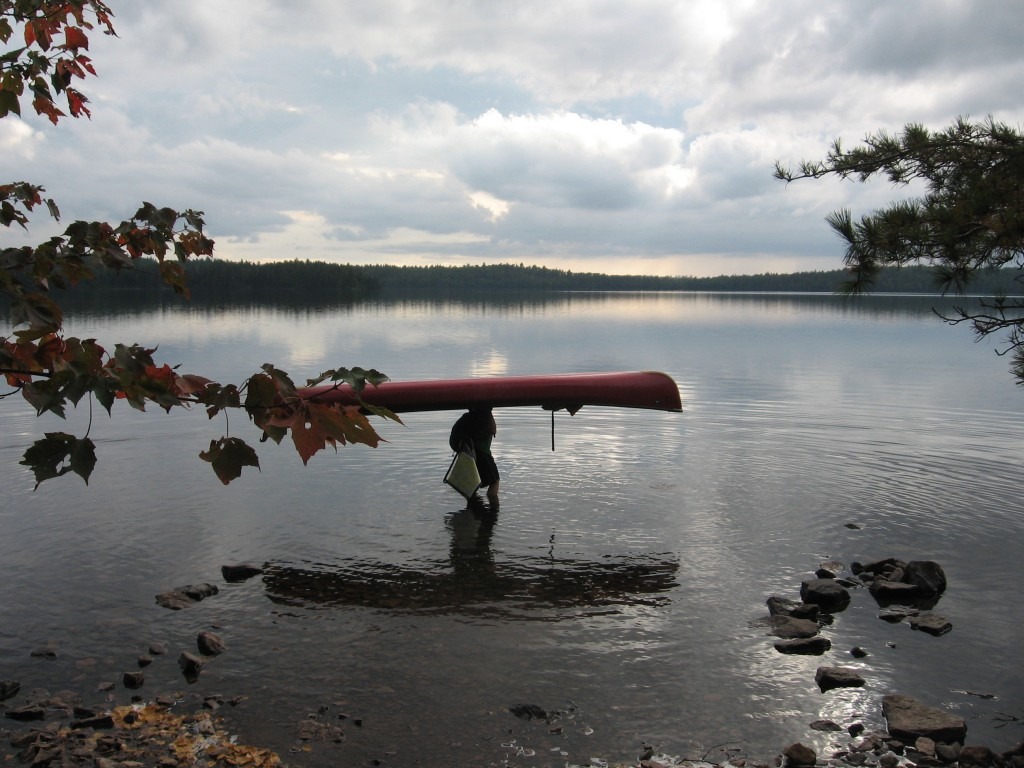 This Sept. 16, 2017 photo shows a visitor to Minnesota's Boundary Waters Canoe Area Wilderness getting ready to put the 16.5-foot canoe back in the wa...