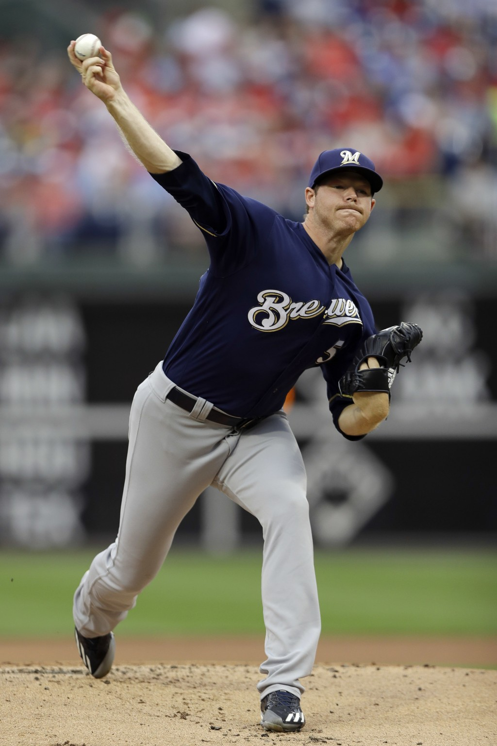 Milwaukee Brewers' Brandon Woodruff pitches during the first inning of a baseball game against the Philadelphia Phillies, Sunday, June 10, 2018, in Ph...