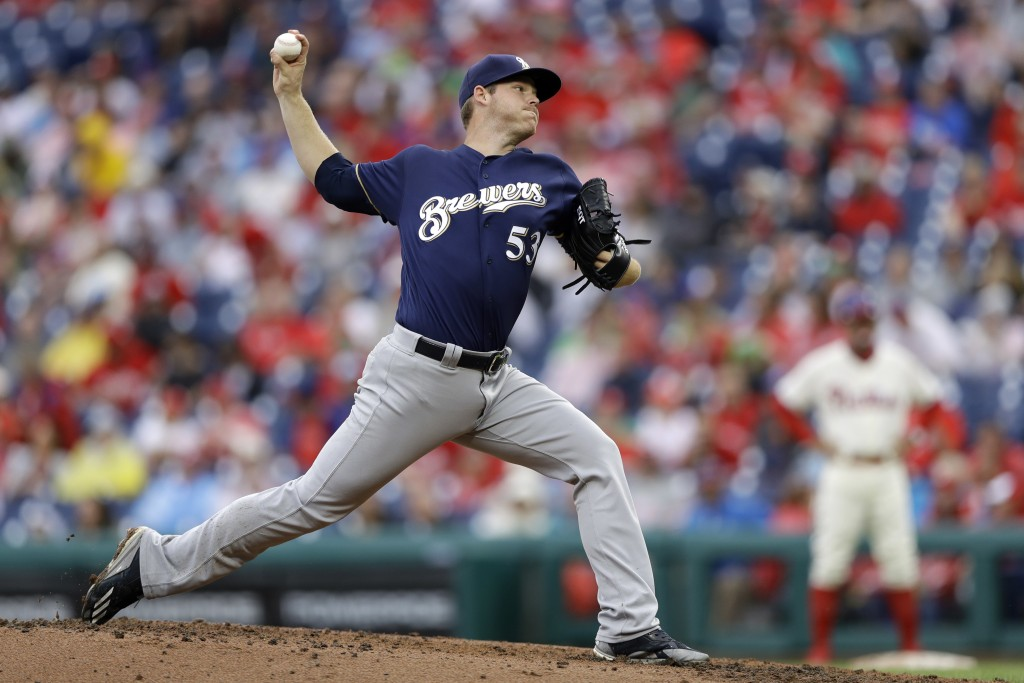 Milwaukee Brewers' Brandon Woodruff pitches during the third inning of a baseball game against the Philadelphia Phillies, Sunday, June 10, 2018, in Ph...