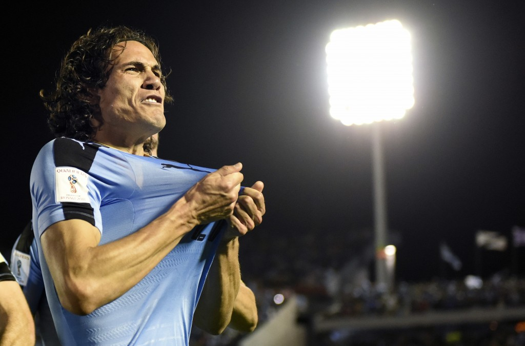 FILE - In this Tuesday, Oct. 10, 2017 filer, Uruguay's Edinson Cavani celebrates after scoring against Bolivia during a 2018 World Cup qualifying socc