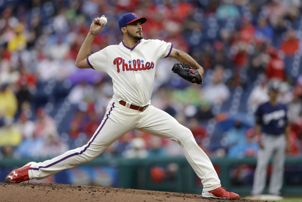 Philadelphia Phillies' Zach Eflin pitches during the third inning of a baseball game against the Milwaukee Brewers, Sunday, June 10, 2018, in Philadel...