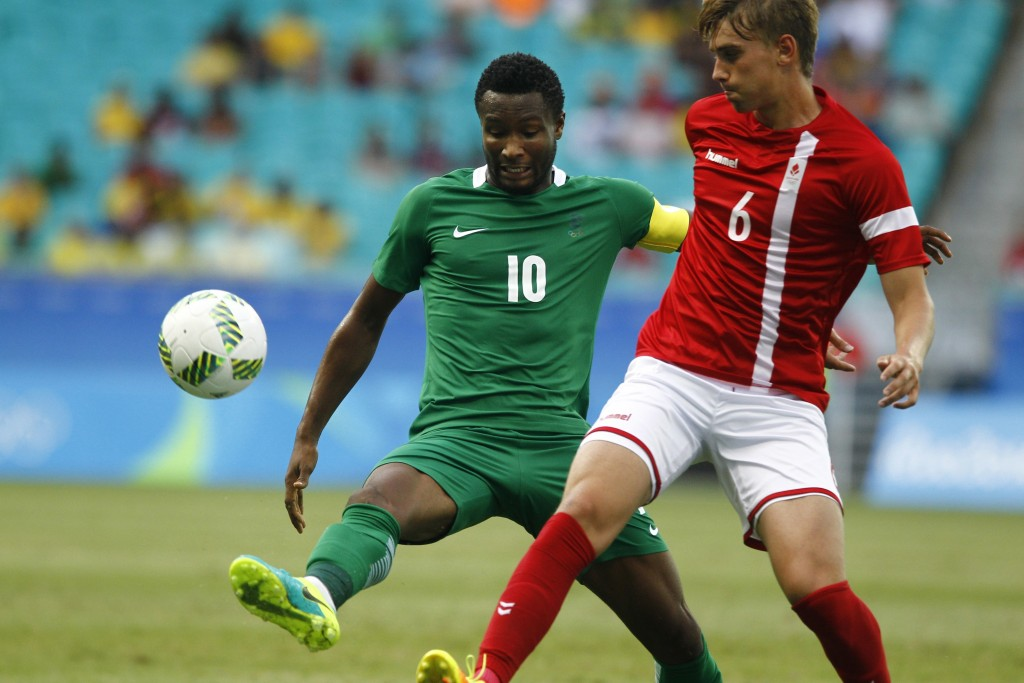 FILE - In this Saturday, Aug. 13, 2016 filer, Nigeria's John Obi Mikel, left, fights for the ball with Denmark's Andres Maxso during a quarter-final m