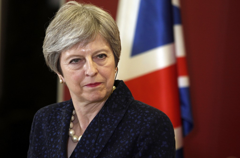 FILE - In this Thursday, May 17, 2018 file photo, British Prime Minister Theresa May looks on during a news conference with her Macedonian counterpart