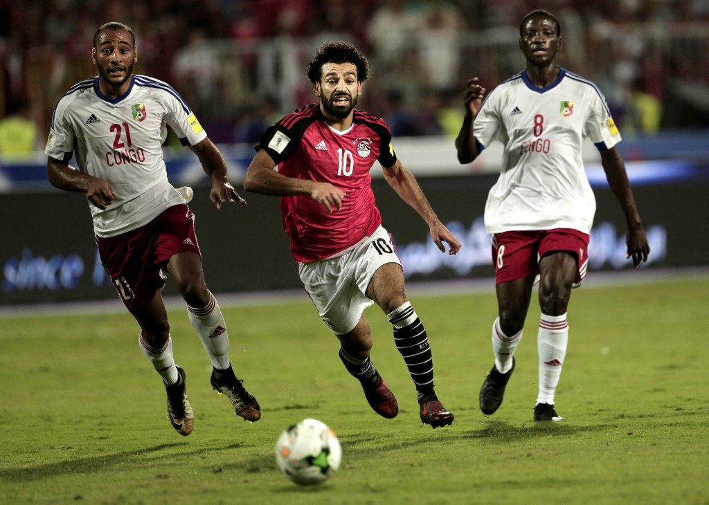 FILE - In this Oct. 8, 2017 file photo, Egypt's Mohamed Salah, center, battles for the ball with Congo's Delvin N'Dinga, right, and Tobias Badila duri