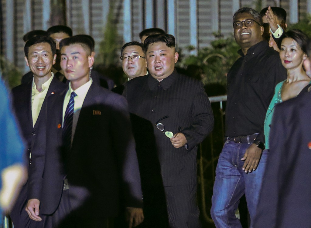 North Korea leader Kim Jong Un, center, is escorted by his security delegation as he visits Marina Bay in Singapore, Monday, June 11, 2018, ahead of K...