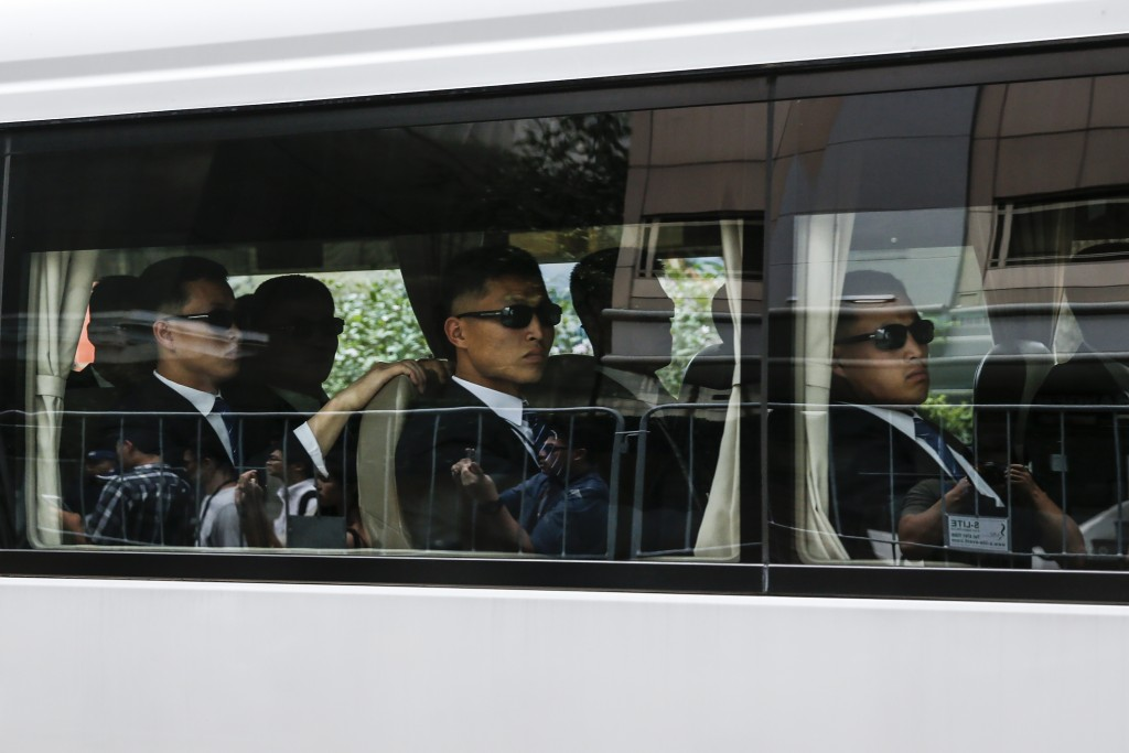 A bus carrying the North Korean security delegation leaves the St. Regis Hotel where North Korean leader Kim Jong Un is staying in Singapore, Monday, ...