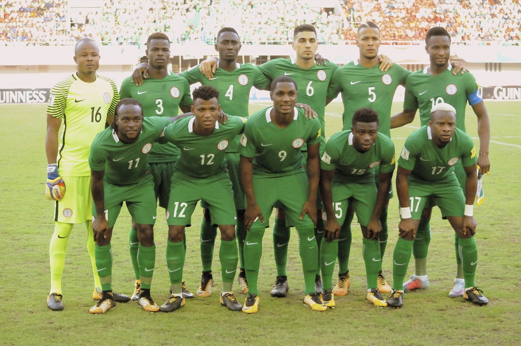 In this photo on taken Saturday Oct.7, 2017 Nigeria's line up team poses for photos before a World Cup soccer qualifier match against Zambia at Godswi