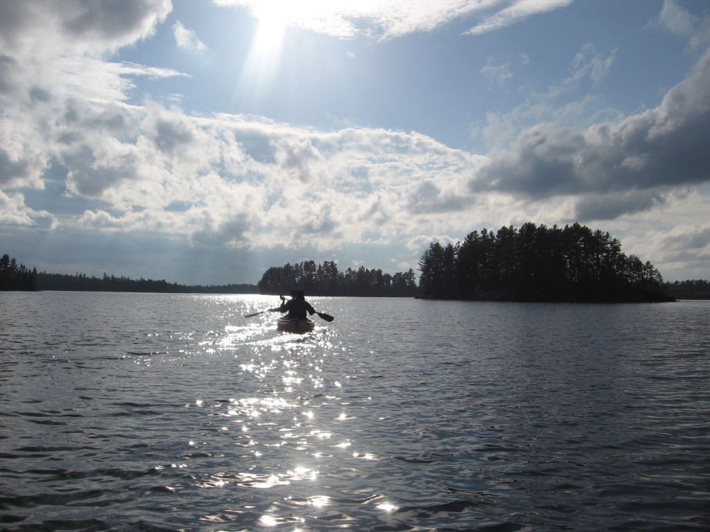 This Sept. 16, 2017 photo shows two canoeists paddling in the late afternoon on Disappointment Lake, one of more than a thousand lakes in Minnesota's ...