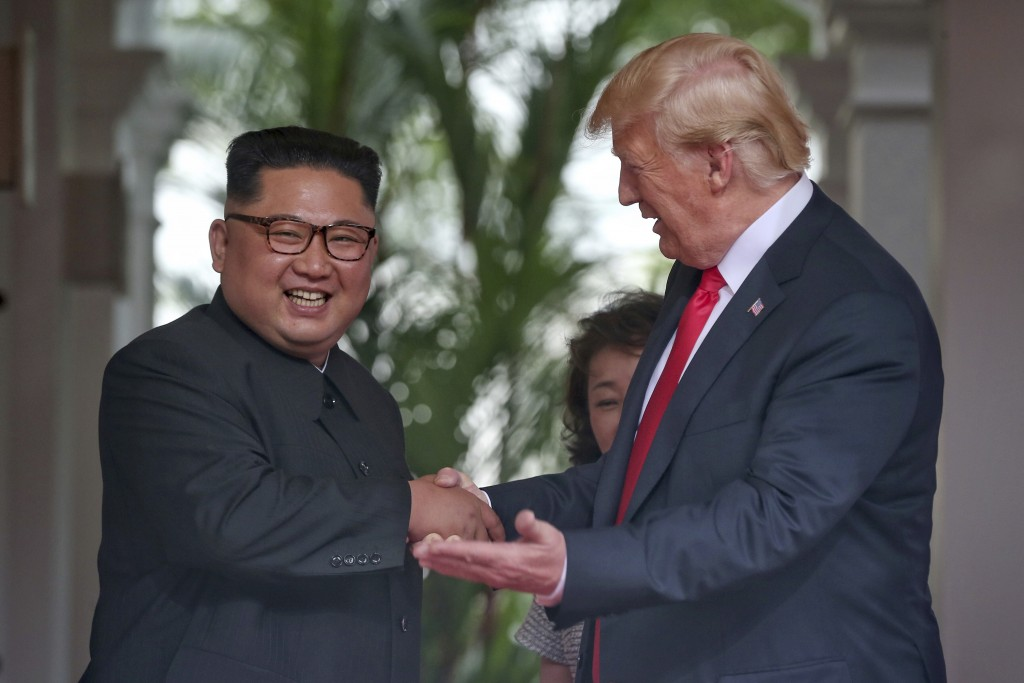 U. S. President Donald Trump shakes hands with North Korea leader Kim Jong Un at the Capella resort on Sentosa Island Tuesday, June 12, 2018 in Singap...