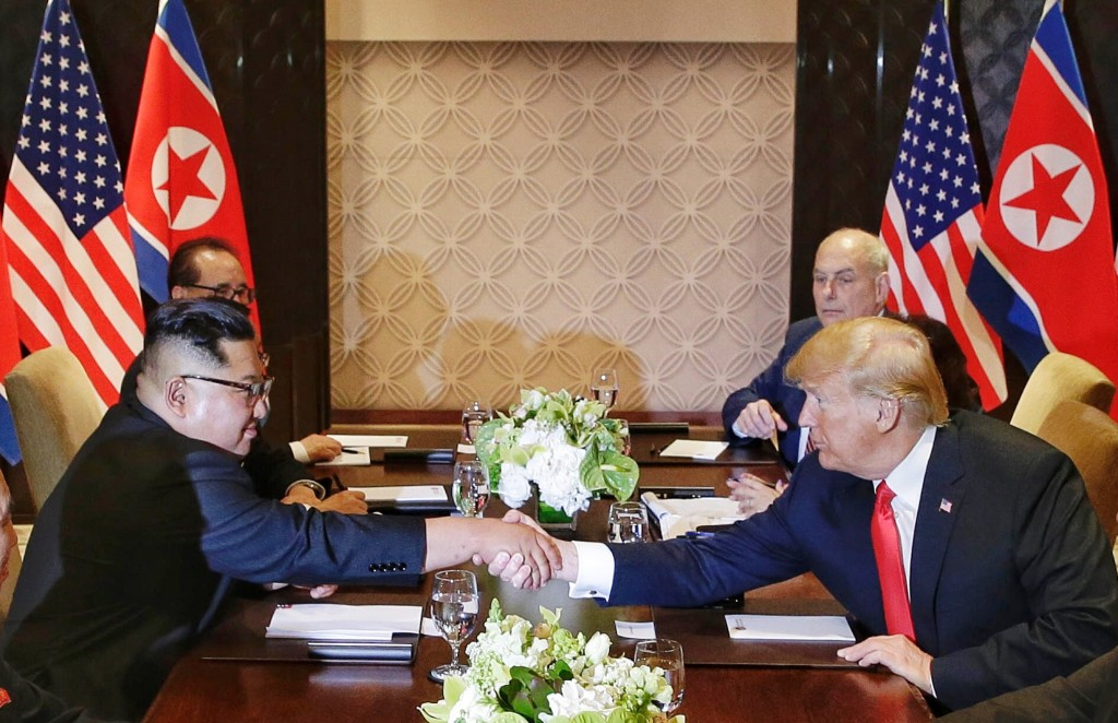 U.S. President Donald Trump shakes hands with North Korean leader Kim Jong Un during their meeting at the Capella resort on Sentosa Island Tuesday, Ju