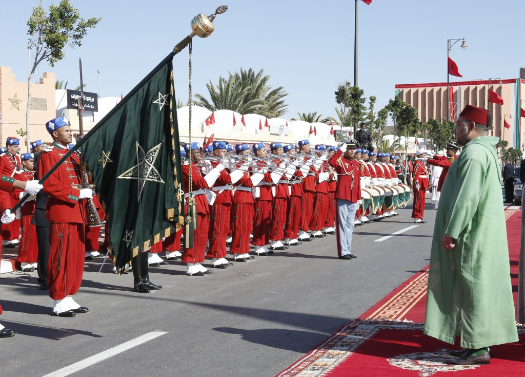 FILE - In this Saturday, Nov. 7, 2015 file photo, Morocco's King Mohammed VI, right, listens to the national anthem in Laayoune, the capital of disput...