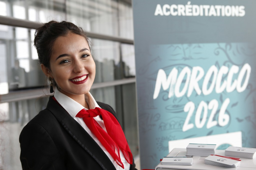 FILE - In this Saturday March 17, 2018, Moroccan hostess Zainab Rchid welcomes media before a press conference to promote Morocco's bid for the 2026 s...