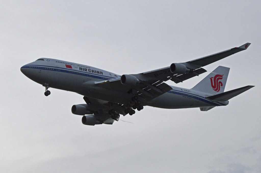 A chartered Air China 747 lands in Singapore suspected to pick up North Korea leader Kim Jong Un on Tuesday, June 12, 2018, after his summit today wit...