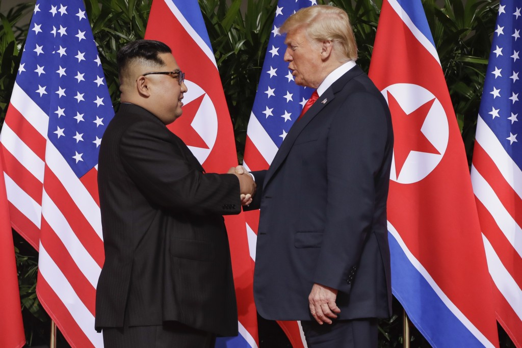 U.S. President Donald Trump shakes hands with North Korea leader Kim Jong Un at the Capella resort on Sentosa Island Tuesday, June 12, 2018 in Singapo