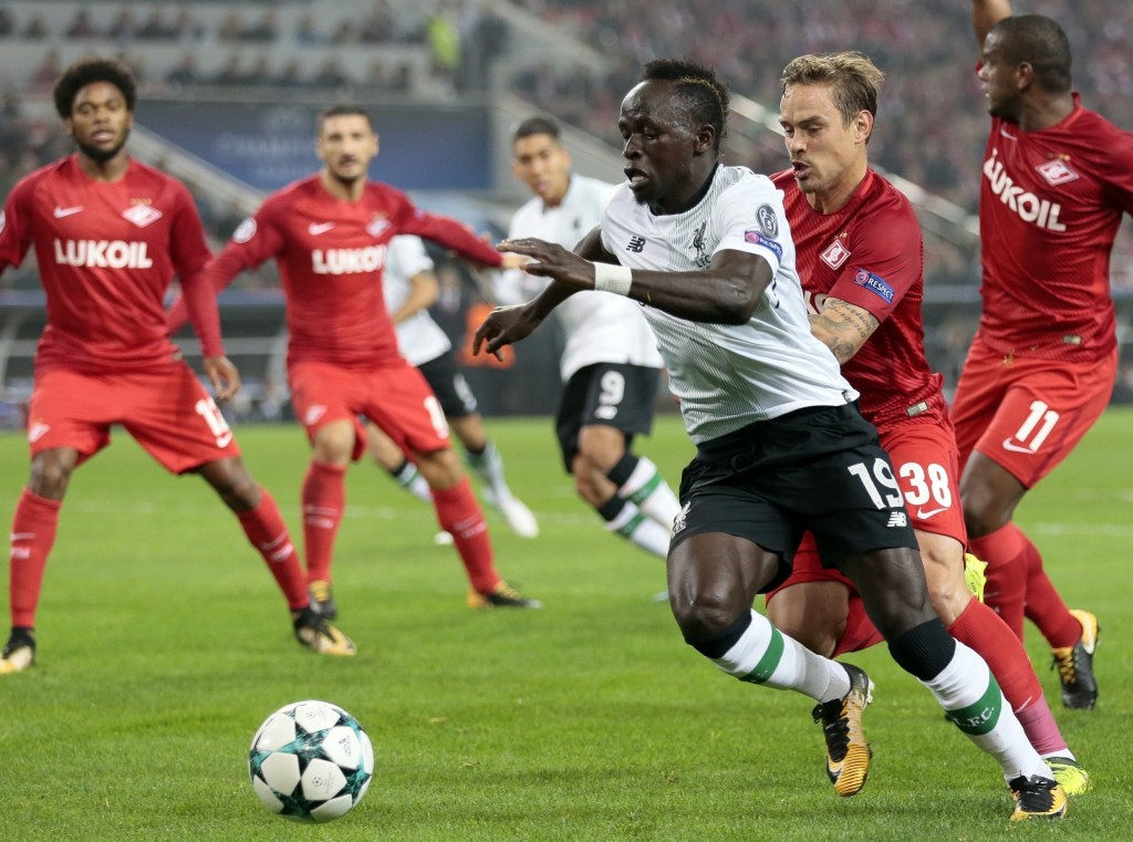 FILE - In this Tuesday, Sept. 26, 2017 file photo, Liverpool's Sadio Mane, front, duels for the ball with Spartak's Andrei Eschenko during the Champio
