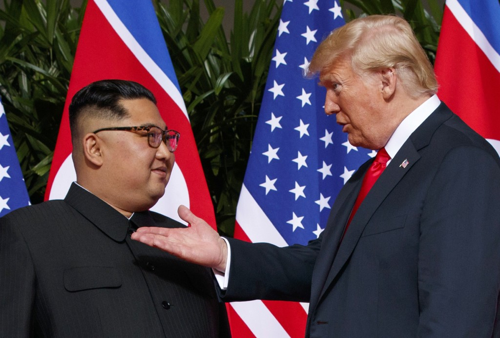 FILE - In this June 12, 2018, file photo, U.S. President Donald Trump, right, meets with North Korean leader Kim Jong Un on Sentosa Island in Singapor