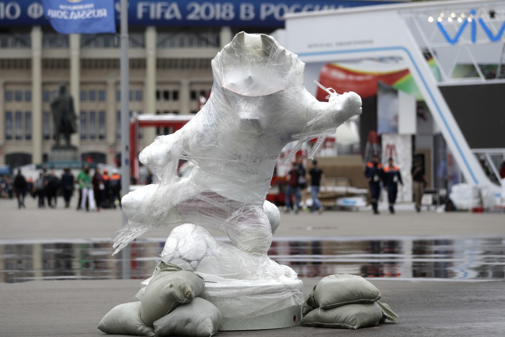 The official mascot Zabivaka stands wrapped outside the stadium after the official training session of the Russian team one the eve of the group A mat