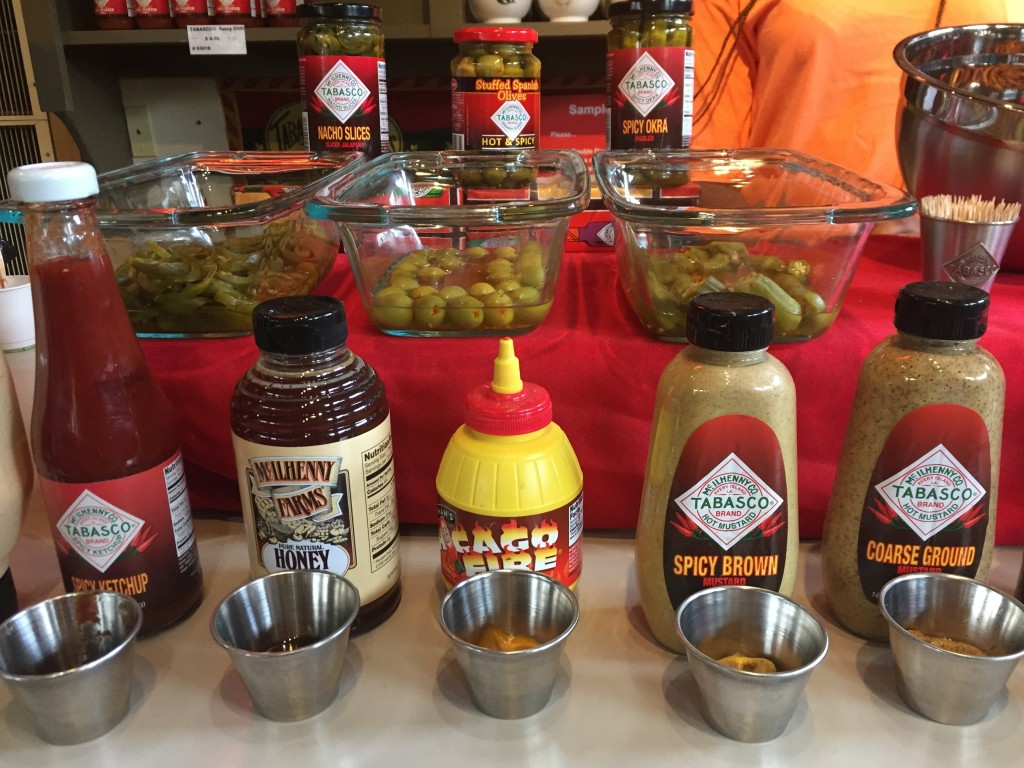 This June 4, 2018 photo shows Tabasco-infused olives and other food and dips in a free taste sample display on Avery Island in Louisiana, where Tabasc