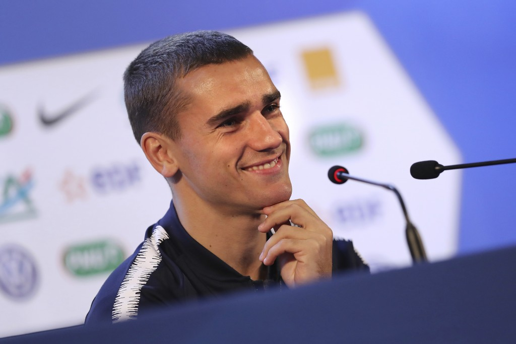 France's Antoine Griezmann smiles as he answers to journalists during a press conference at the 2018 soccer World Cup in Istra, Russia, Tuesday, June