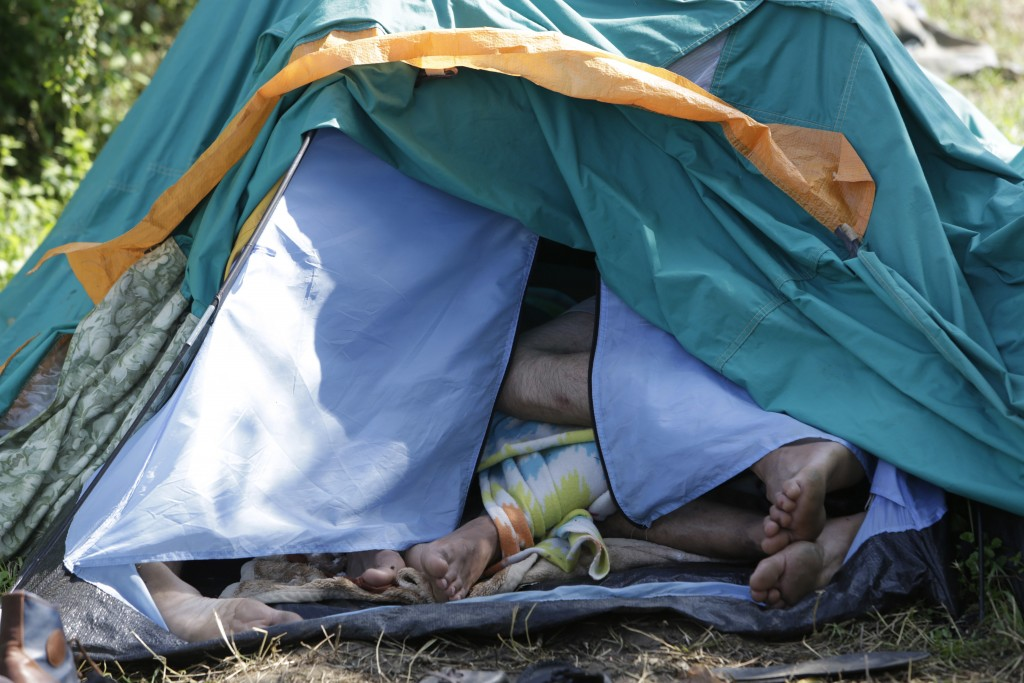 In this photo taken on Sunday, June. 10, 2018, migrants sleep inside a tent in a make-shift tent camps in Velika Kladusa, 400 kms north west of Bosnia