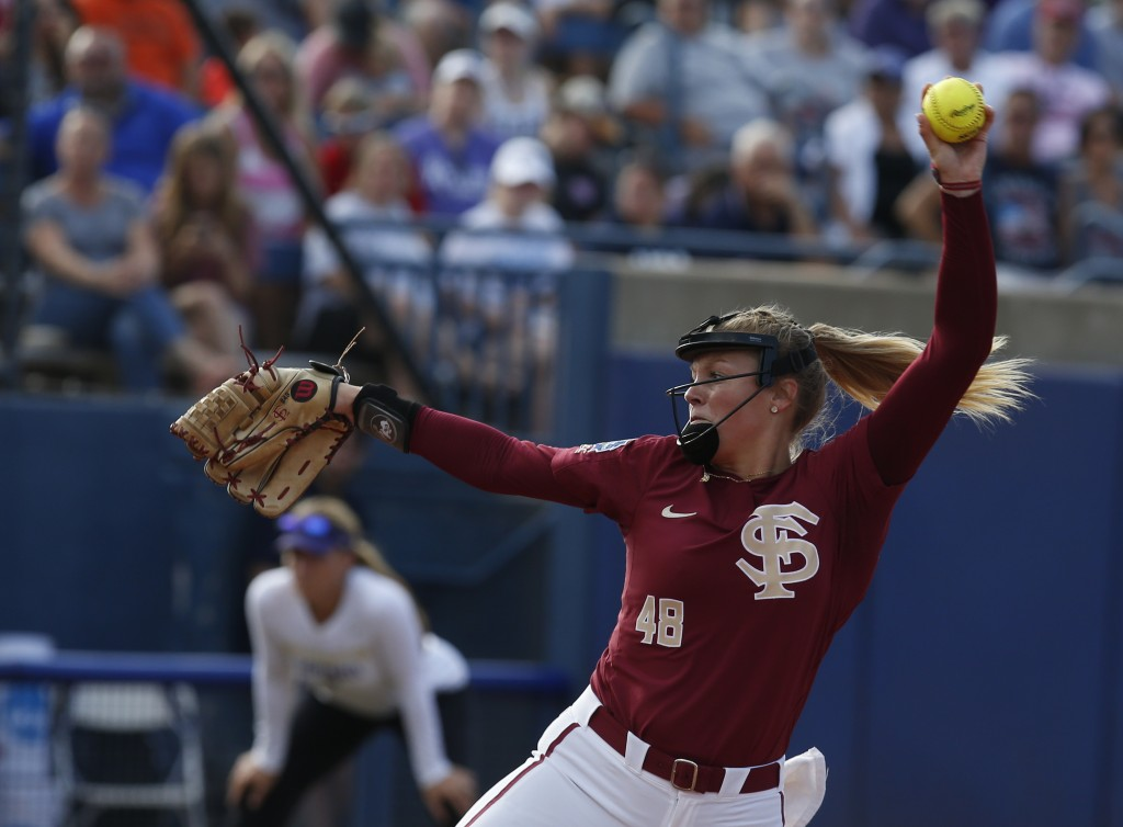 Florida State starting pitcher/relief pitcher Meghan King (48) pitches in the first game of the best-of-three championship series in the NCAA Women's