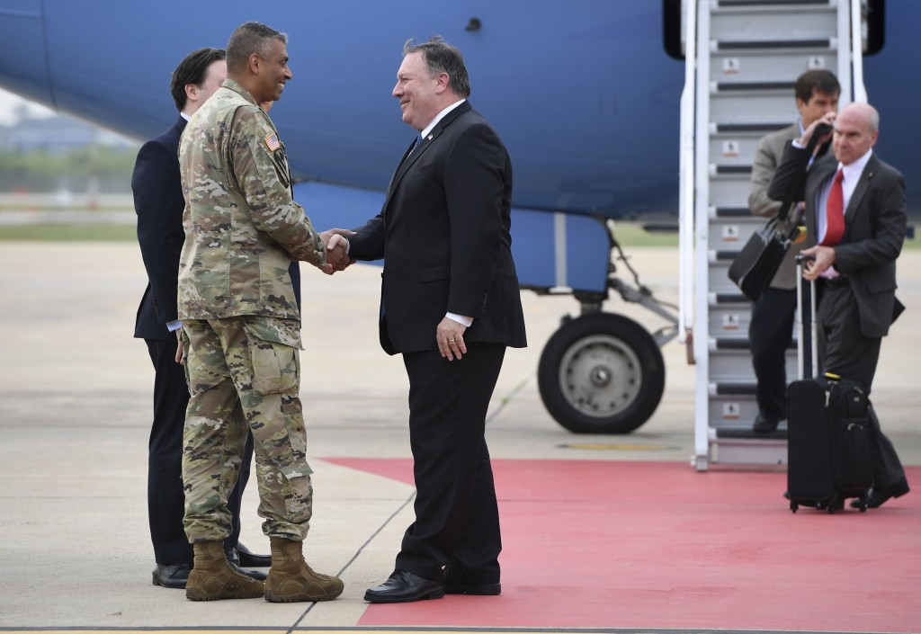 U.S. Secretary of State Mike Pompeo, center,  shakes hands with U.S. General Vincent K. Brooks, commander of United States Forces Korea, upon his arri...