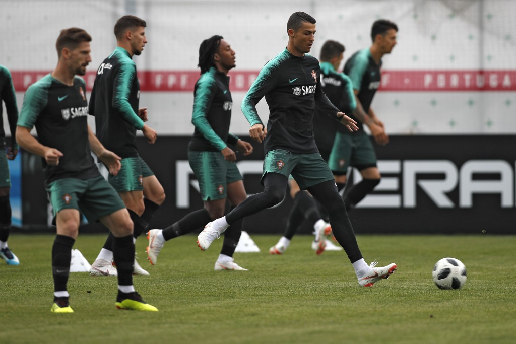 Portugal's Cristiano Ronaldo, right, plays the ball with teammates during the training session of Portugal at the 2018 soccer World Cup in Kratovo, ou