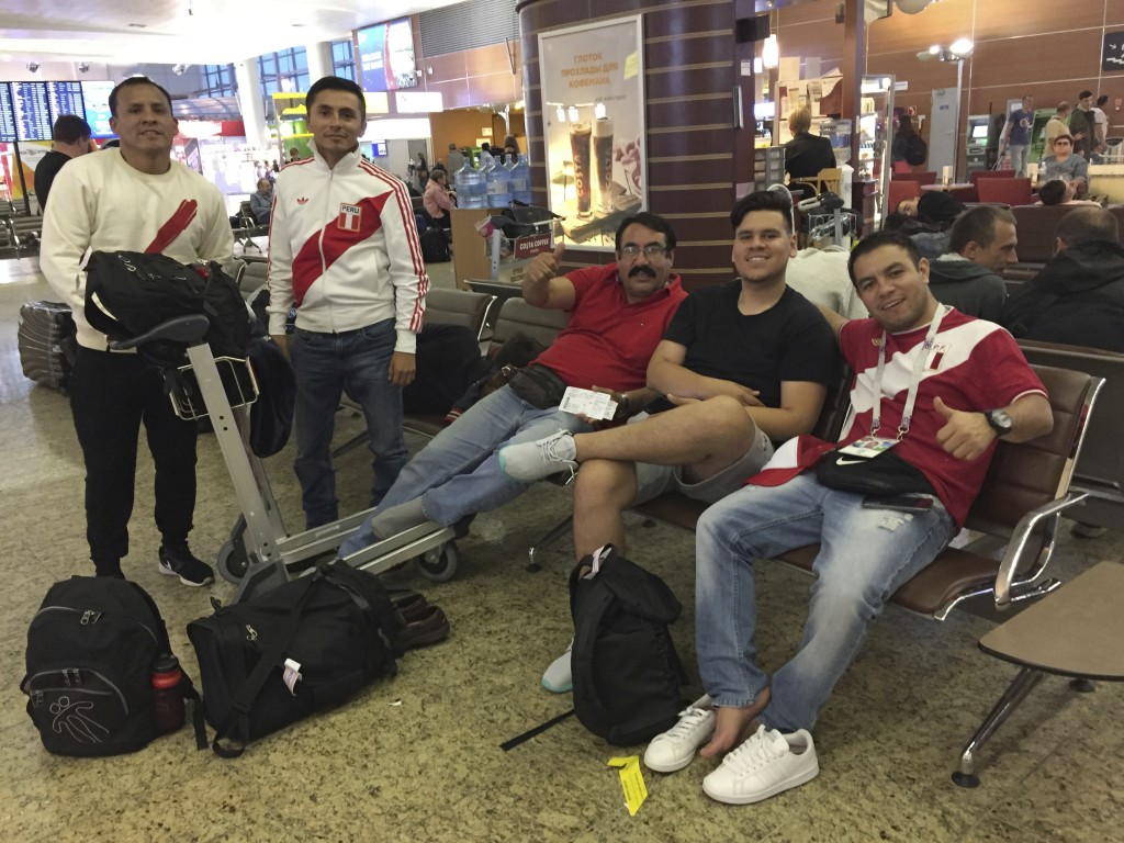 In this June 12, 2018 photo, Peruvian fans Jose Jimenez, second left, his childhood friend Jorge Oxa, left, Oxa's father Rolando Ubillus, center, and