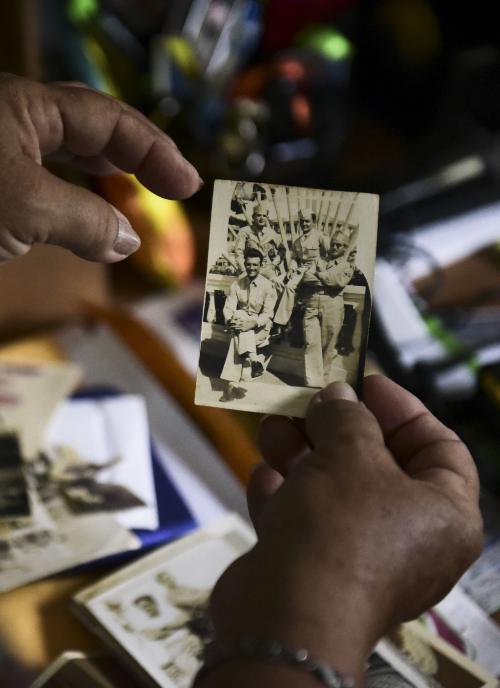 Nerybelle Perez holds a picture of her father, World War II veteran Efrain Perez, who died inside an ambulance after being turned away from the larges...