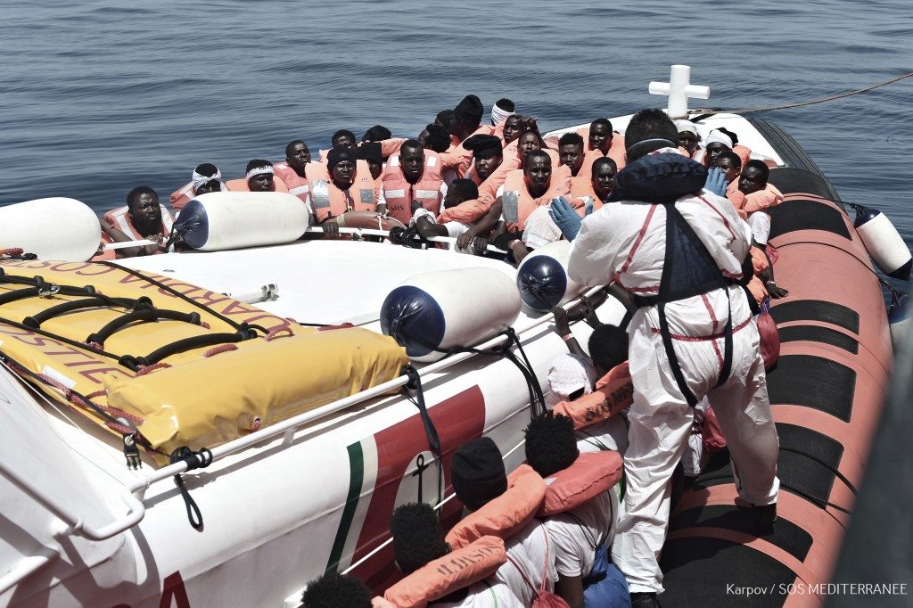 "This June 12, 2018 photo released Wednesday, June 13, 2018 by French NGO ""SOS Mediterranee"" shows migrants being transferred from the Aquarius ship to"