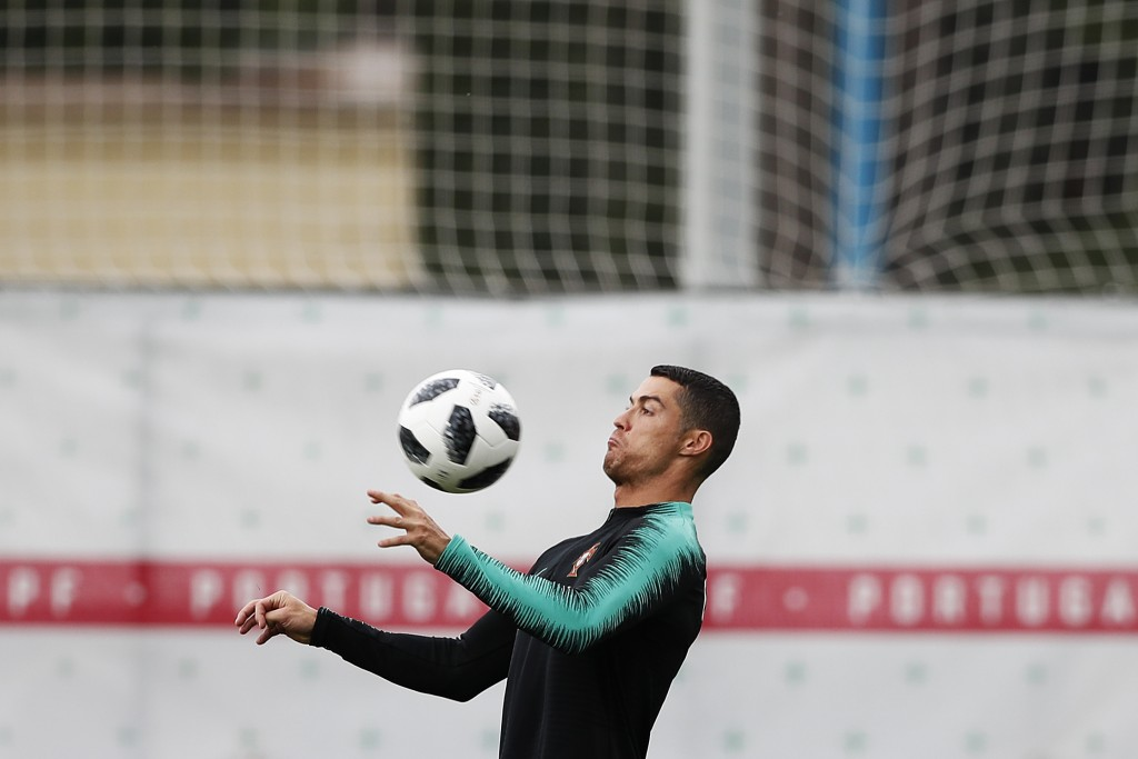 Portugal's Cristiano Ronaldo controls the ball during the training session of Portugal at the 2018 soccer World Cup in Kratovo, outskirts Moscow, Russ