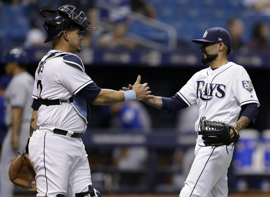 Tampa Bay Rays pitcher Sergio Romo and catcher Wilson Ramos celebrate after the Rays defeated the Toronto Blue Jays 4-1 in a baseball game Tuesday, Ju...