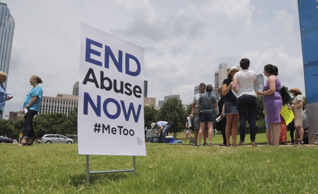 A small group of protesters fighting various forms of abuse within the church engage passersby outside at the Southern Baptist Convention meeting in D