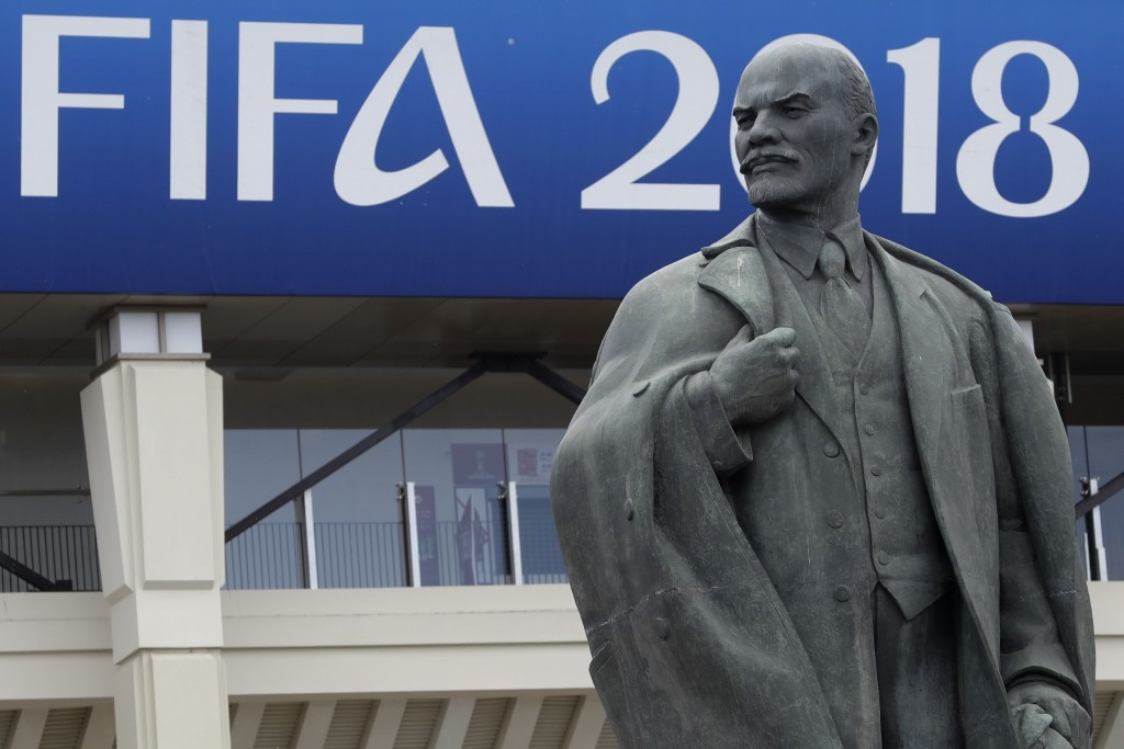 A statue of Lenin stands outside the stadium after the official training session of the Russian team one the eve of the group A match between Russia a