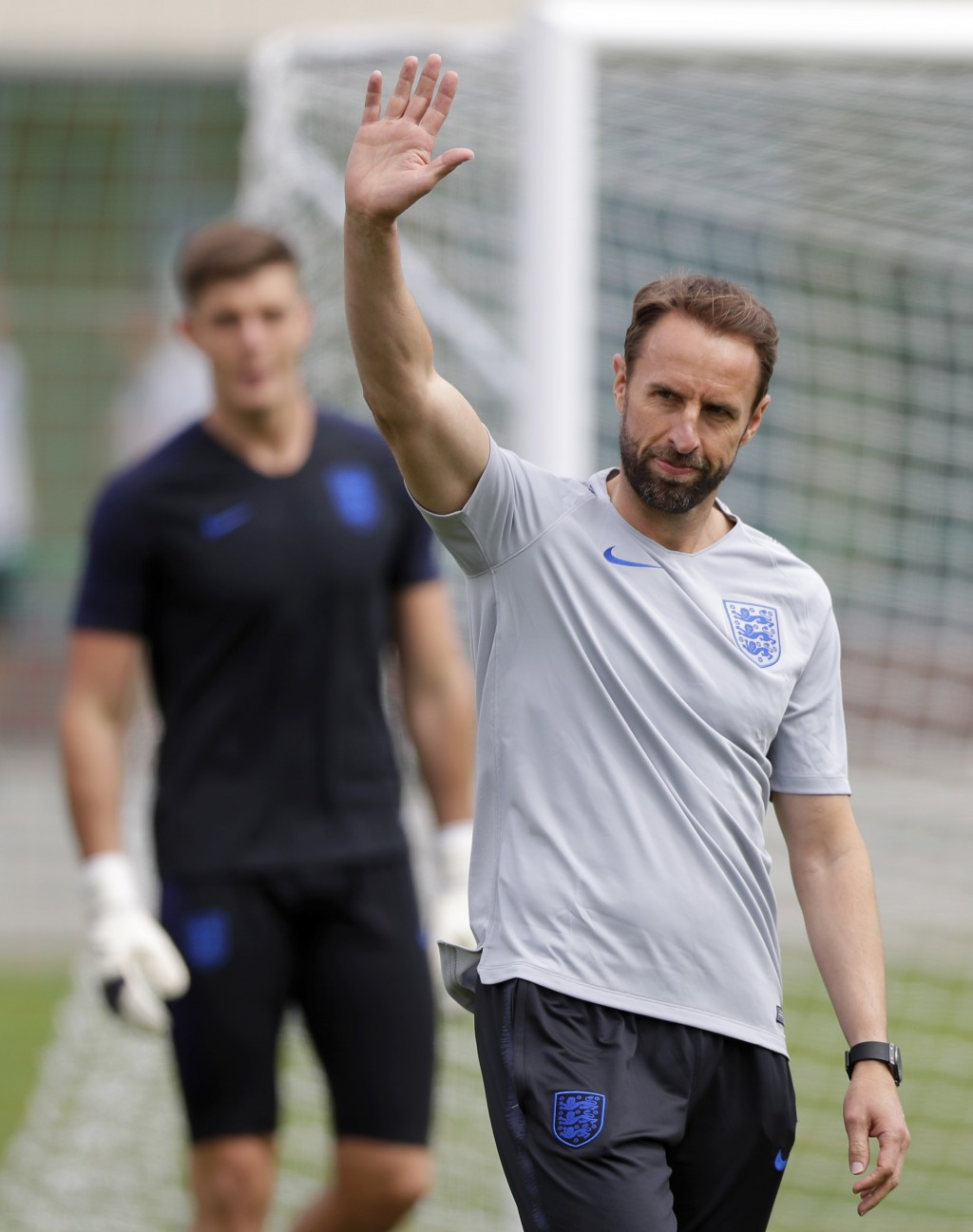 England head coach Gareth Southgate waves to the invited fans during a training session for the England team at the 2018 soccer World Cup, in the Spar
