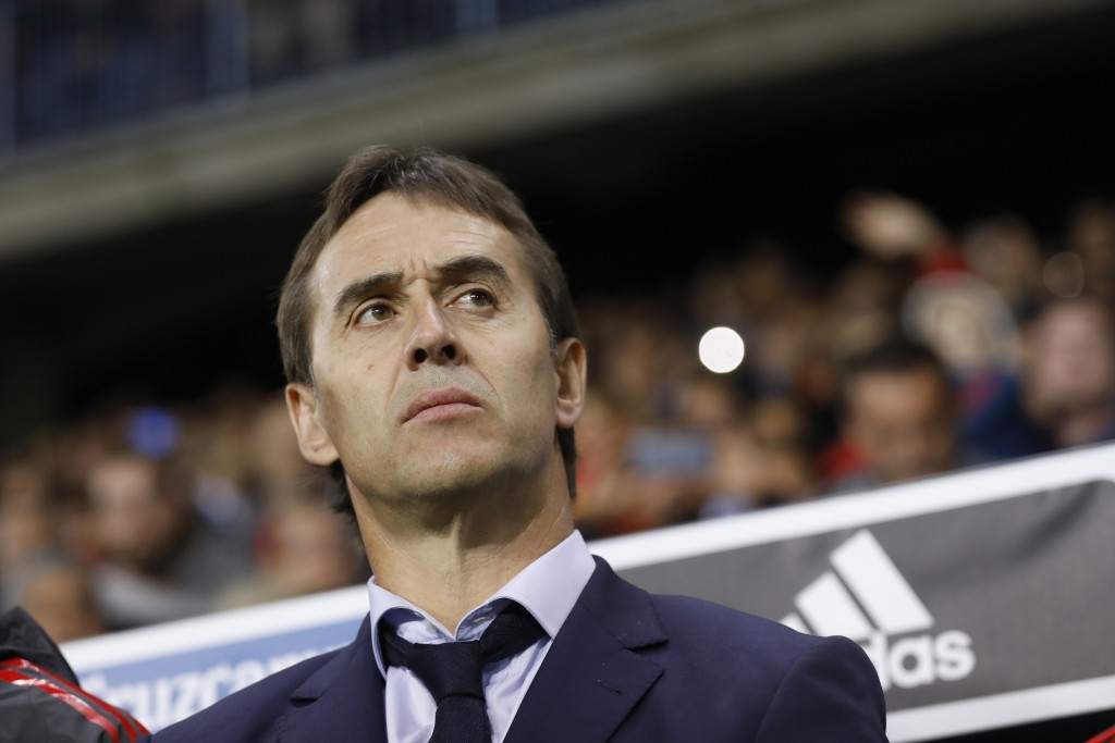 FILE - In this Saturday, Nov. 11, 2017 filer, Spain coach Julen Lopetegui stands by the bench during the international friendly soccer match between S