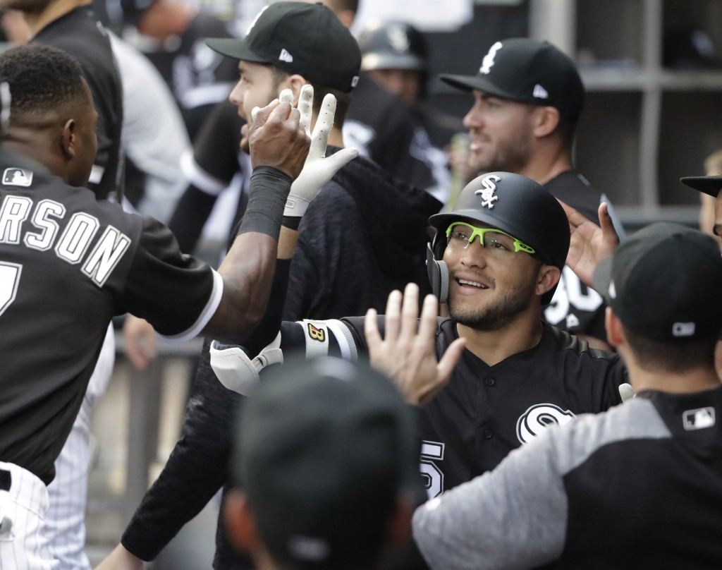 Chicago White Sox's Yolmer Sanchez is congratulated for his home run off Cleveland Indians starting pitcher Adam Plutko during the first inning of a b