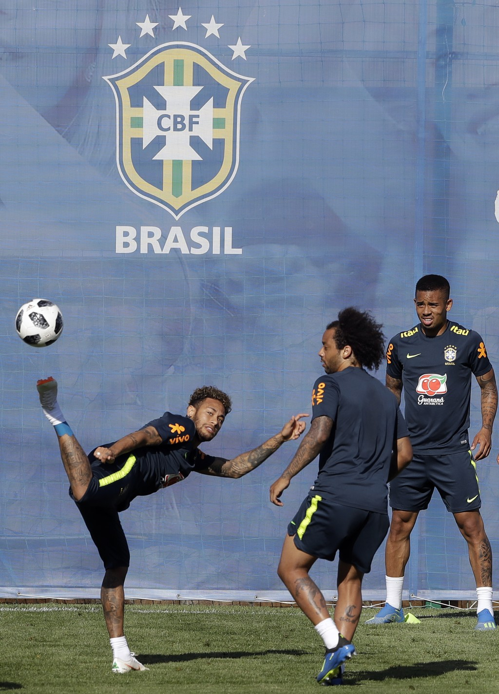 Brazil's Neymar, left, Marcelo, center, and Gabriel Jesus, practice during a training session in Sochi, Russia, Wednesday, June 13, 2018. Brazil will