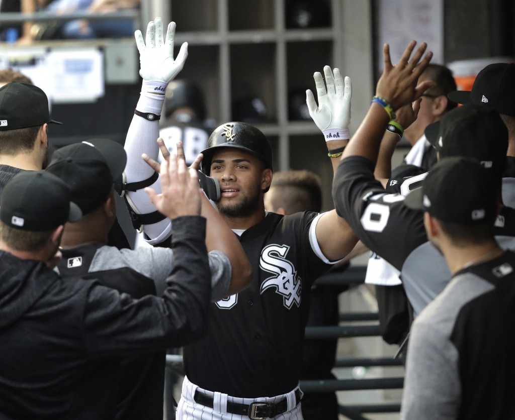 Chicago White Sox's Yoan Moncada celebrates his home run off Cleveland Indians starting pitcher Adam Plutko during the first inning of a baseball game