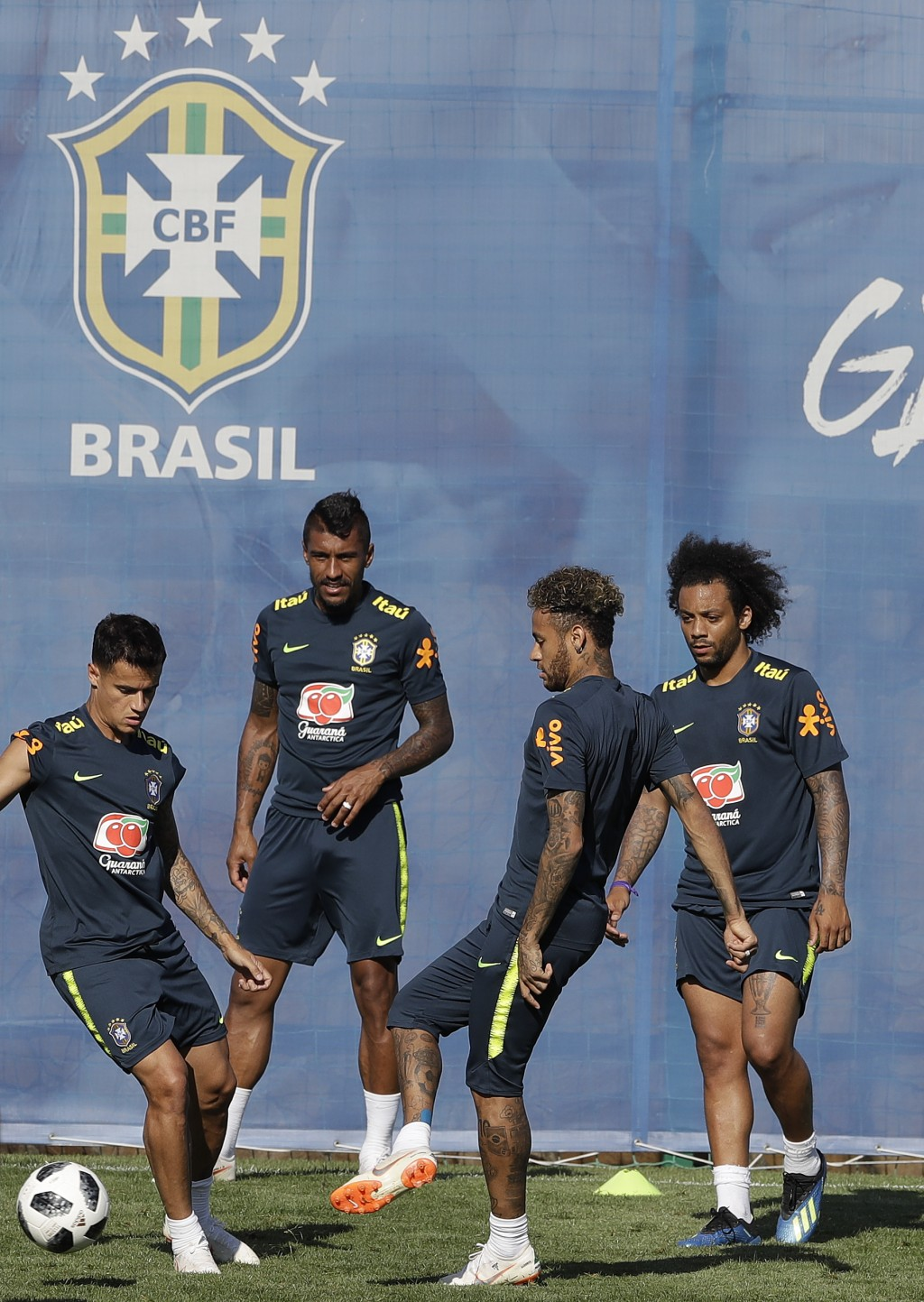Brazil's soccer players from left, Philippe Coutinho, Paulinho, Neymar, and Marcelo, practice during a training session in Sochi, Russia, Wednesday, J