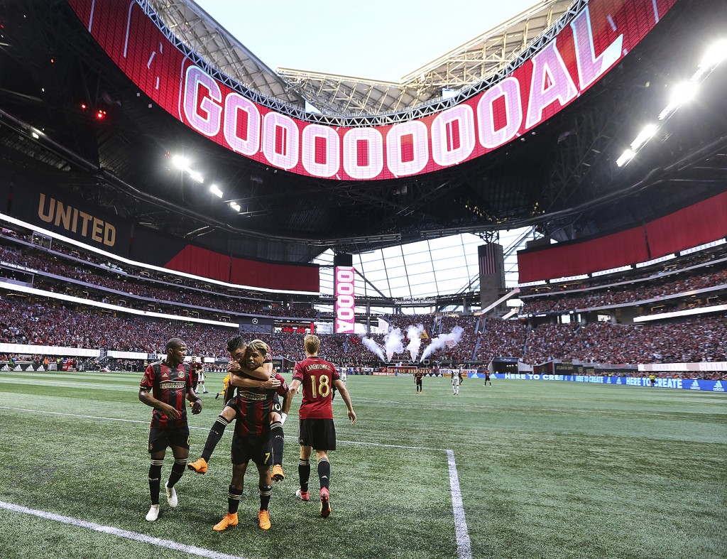 FILE - In this June 2, 2018, file photo, the roof of Mercedes-Benz Stadium is open as Atlanta United forward Josef Martinez celebrates his goal agains