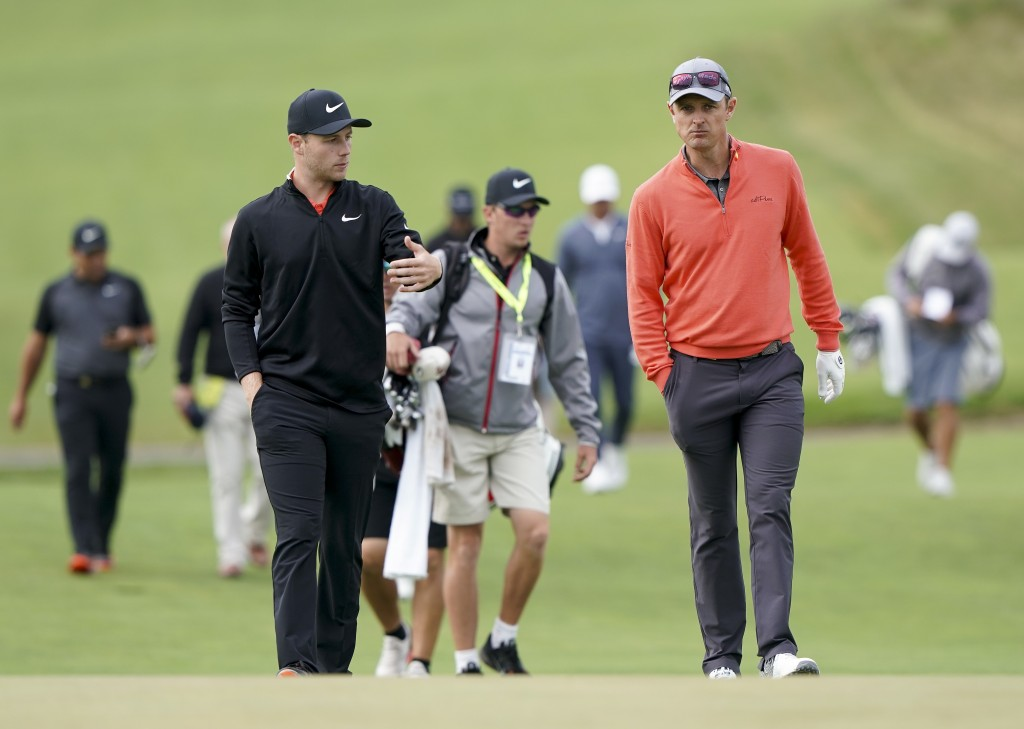 Harry Ellis, left, and Justin Rose, both of England walk up the 12th fairway during a practice round for the U.S. Open Golf Championship, Wednesday, J