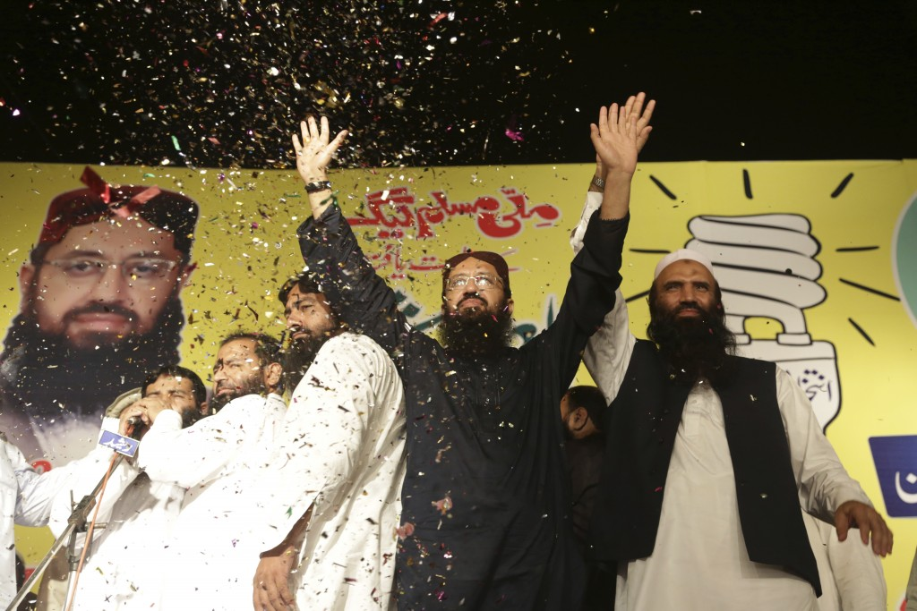 FILE - In this Thursday, Sept. 14, 2017 file photo, Sheikh Yaqub, center, candidate of the newly-formed Milli Muslim League party, waves to his suppor