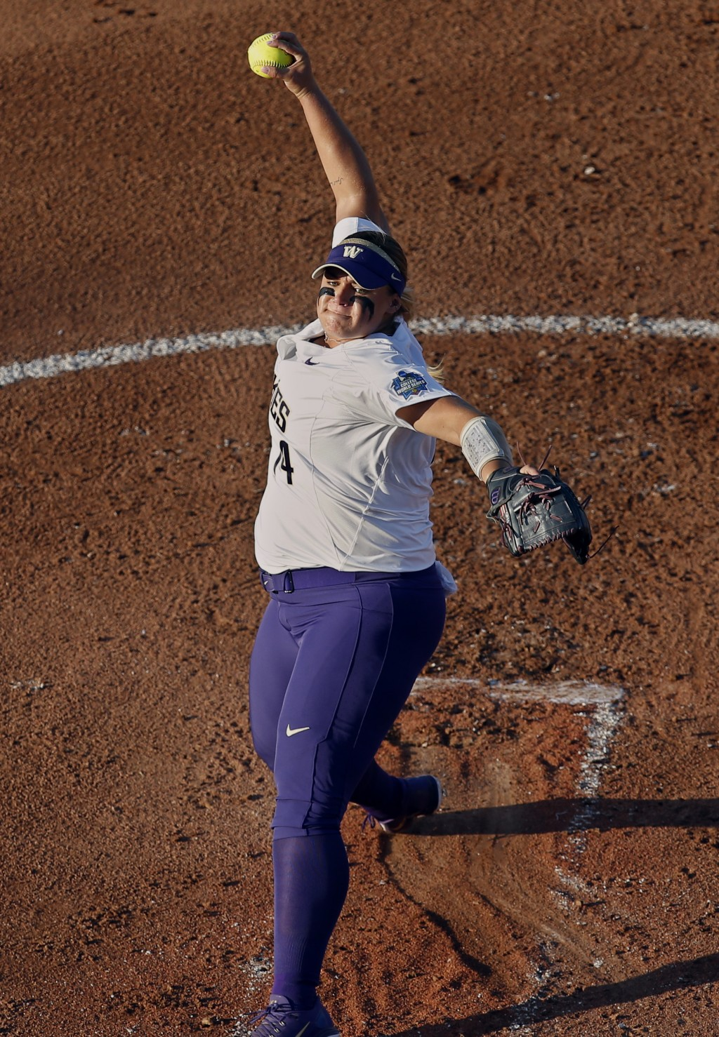Washington starting pitcher Taran Alvelo (14) pitches in the first inning of the second softball game of the best-of-three championship series in the