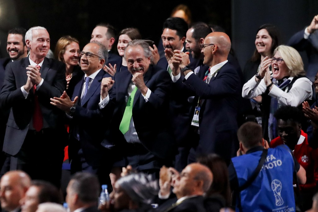 Delegates of Canada, Mexico and the United States celebrate after winning a joint bid to host the 2026 World Cup at the FIFA congress in Moscow, Russi