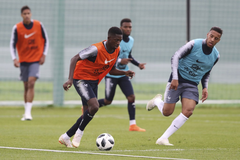 France's Ousmane Dembele dribbles the ball during a training session at the 2018 soccer World Cup in Glebovets, Russia, Tuesday, June 12, 2018. (AP Ph