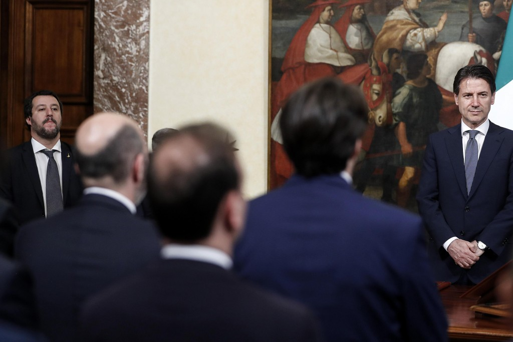 Italian Interior minister Matteo Salvini, left, and Italian Premier Giuseppe Conte, right attend the swearing-in ceremony for the new undersecretaries