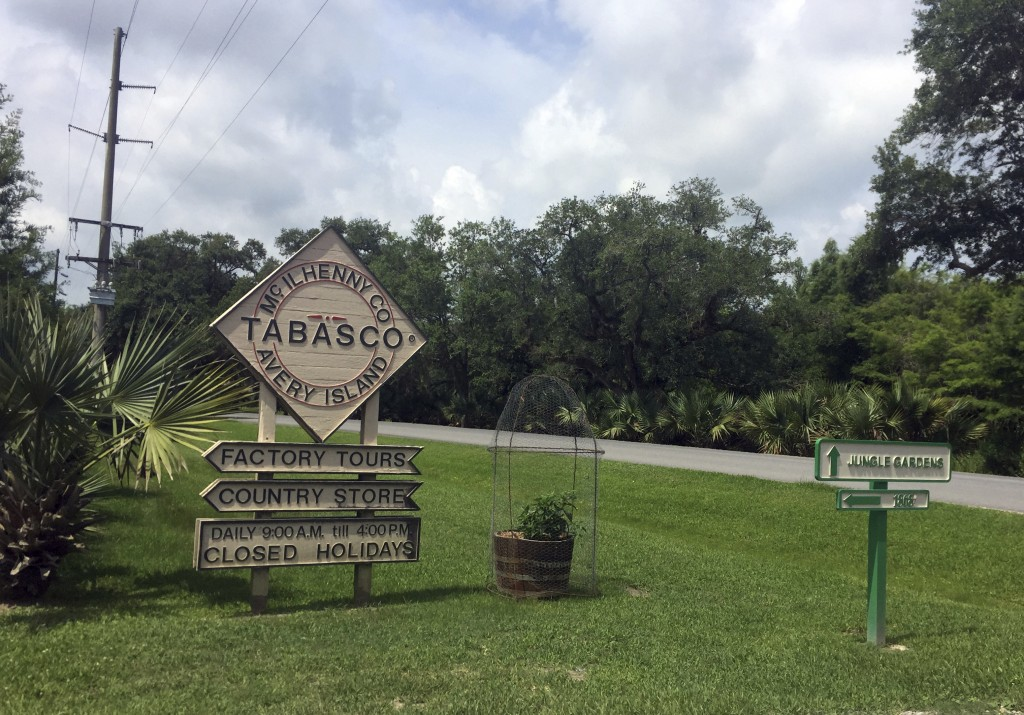 This June 4, 2018 photo shows a sign directing visitors to attractions on Avery Island in Louisiana, where Tabasco sauce is made. The product was firs